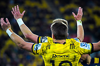 Barrett brothers Beauden and Jordie appeal to the referee during the Super Rugby match between the Hurricanes and Highlanders at Westpac Stadium in Wellington, New Zealand on Friday, 1 March 2019. Photo: Dave Lintott / lintottphoto.co.nz