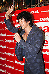 Japanese singer and comedian Tomoharu Shoji greets to the people during the ''Seminaked in Red'' event at Desigual Harajuku store on June 27, 2015, Tokyo, Japan. Spanish fashion label's promotional event offered the first 100 participants who arrived wearing swimsuits a discount on all in store items. According to the organizers around 100 people lined up over night despite the heavy rain. (Photo by Rodrigo Reyes Marin/AFLO)