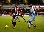 Samir Carruthers of Sheffield Utd and Bryan Oviedo of Sunderland during the Championship match at Bramall Lane Stadium, Sheffield. Picture date 26th December 2017. Picture credit should read: Simon Bellis/Sportimage