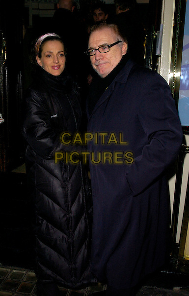 "BRIAN COX & GUEST.""The Lady From Dubuque"" gala evening, Theatre Royal Haymarket, London, UK..March 19th, 2007.half length black coat glasses.CAP/CAN .©Can Nguyen/Capital Pictures"