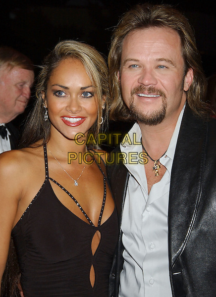 TRAVIS TRITT & WIFE TERESA.2005 BMI Awards held at BMI Nashville Headquarters..USA, United States.18 October 2005.Ref:ADM/LF.half length together couple wife husband married black leather suit white shirt beard goatee moustache revealing dress low cut plunging neckline.www.capitalpictures.com.sales@capitalpictures.com.©Laura Farr/AdMedia/Capital Pictures.