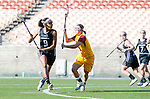 Los Angeles, CA 02/09/13 - Taylor Thornton  (Northwestern #9) and Haleigh Dalmass (USC #8) in action during the Northwestern vs USC NCAA Women Lacrosse game at the Los Angeles Colliseum.