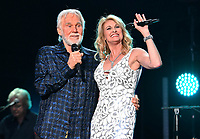 """20 March 2020 - Kenny Rogers, whose legendary music career spanned nearly six decades, has died at the age of 81. Rogers was inducted to the Country Music Hall of Fame in 2013."""" He had 24 No. 1 hits and through his career more than 50 million albums sold in the US alone. He was a six-time Country Music Awards winner and three-time Grammy Award winner. Some of his hits included """"Lady,"""" """"Lucille,"""" """"We've Got Tonight,"""" """"Islands In The Stream,"""" and """"Through the Years."""" His 1978 song """"The Gambler"""" inspired multiple TV movies, with Rogers as the main character. File Photo: 08 June 2017 - Nashville, Tennessee - Kenny Rogers, Linda Davis. 2017 CMA Music Festival Nightly Concert held at Nissan Stadium. Photo Credit: Laura Farr/AdMedia"""