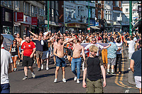 BNPS.co.uk (01202 558833)<br /> Pic: LeeMcLean/BNPS<br /> <br /> Final whistle....<br /> <br /> Sizzling Saturday in Bournemouth as football fever gripped the seaside resort, with fans havng to resort to peering in windows as all the bars were full.