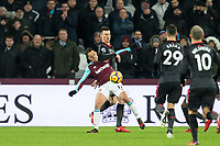 Javier Hernandez of West Ham United & Laurent Koscielny of Arsenal during the Premier League match between West Ham United and Arsenal at the Olympic Park, London, England on 13 December 2017. Photo by Andy Rowland.