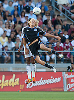 Stanford, California - Saturday June 30, 2012: Steven Lenhart and David Junior Lopes jumps for the ball during a game at Stanford Stadium, Stanford, Ca.San Jose Earthquakes defeated Los Angeles Galaxy,  4 to 3