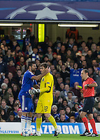 Diego Costa of Chelsea puts his arm round Goalkeeper Iker Casillas of FC Porto as the chelsea player is handed a yellow card from Referee Cüneyt Çakir during the UEFA Champions League group G match between Chelsea and FC Porto at Stamford Bridge, London, England on 9 December 2015. Photo by Andy Rowland.