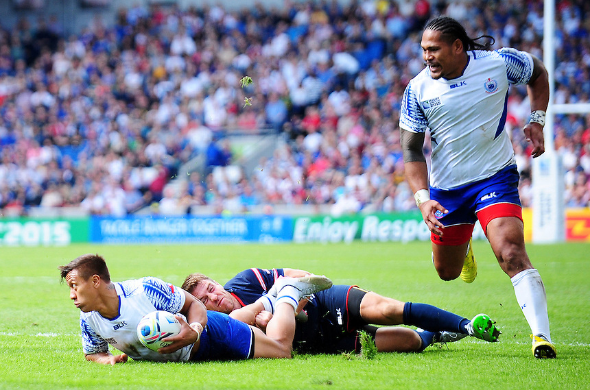 Samoa's Tim Nanai-Williams is tackled by USA's Chris Wyles<br /> <br /> Photographer Kevin Barnes/CameraSport<br /> <br /> Rugby Union - 2015 Rugby World Cup - Samoa v USA - Sunday 20th September 2015 - Brighton Community Stadium - Falmer - Brighton<br /> <br /> &copy; CameraSport - 43 Linden Ave. Countesthorpe. Leicester. England. LE8 5PG - Tel: +44 (0) 116 277 4147 - admin@camerasport.com - www.camerasport.com