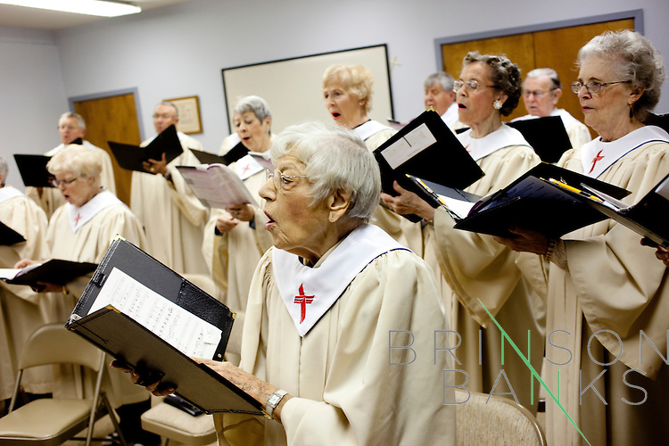 """Members of the choir of the Fountain of Life Lutheran Church rehearse before church in Sun City, Arizona January 10, 2010. In front is Mildred Hansen, 95, who has been a member of the church since it was founded in 1971. She moved to Sun City to retire, she said, """"only we didn't retire when we got here."""""""