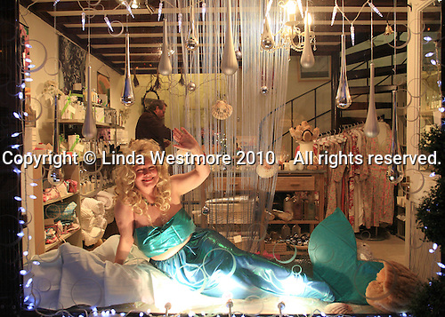 """Once a year, the villagers dress up and become """"Live"""" shop windows to raise money for charity, Petworth, Sussex."""