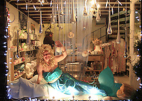 "Once a year, the villagers dress up and become ""Live"" shop windows to raise money for charity, Petworth, Sussex."