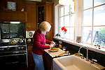 The Oregon City historic home of Dan and Sheryl Hall. Sheryl baking a pie in the kitchen in the morning.