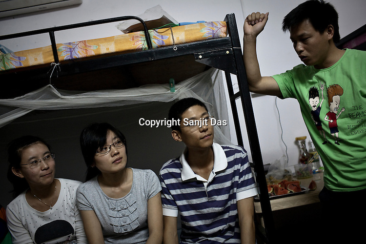 Young Chinese employees hang out at one of their colleague's dormitory in the Chinese Colony of the Adani Power Plant in Mundra port industrial city of Gujarat, India. Indian power companies have handed out dozens of major contracts to Chinese firms since 2008. Adani Power Ltd have built elaborate Chinatowns to accommodate Chinese workers, complete with Chinese chefs, ping pong tables and Chinese television. Chinese companies now supply equipment for about 25% of the 80,000 megawatts in new capacity.