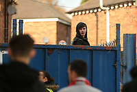 A protesting Macclesfield Town fan looks over the gates during the game during Macclesfield Town vs Kingstonian, Emirates FA Cup Football at the Moss Rose Stadium on 10th November 2019