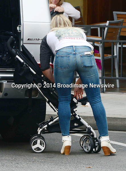 Pictured: Hilary Duff<br /> Mandatory Credit &copy; RDLA/Broadimage<br /> Hilary Duff and Luca out and about in Beverly Hills <br /> <br /> 3/29/14, Beverly Hills, California, United States of America<br /> <br /> Broadimage Newswire<br /> Los Angeles 1+  (310) 301-1027<br /> New York      1+  (646) 827-9134<br /> sales@broadimage.com<br /> http://www.broadimage.com