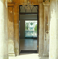 A view through the Georgian stone entrance of the rectory to the starkly modern interior