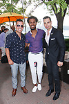 "Fashion designer Edwing D'Angelo (center) posing with guests at his Edwing D'Angelo Spring Summer 2019 ""Pristine"" collection fashion show at Sofrito in New York City on July 11, 2018; during New York Fashion Week: Men's Spring Summer 2019."
