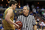 10 March 2016: Referee Tim Nestor (right) checks on Notre Dame's Steve Vasturia (left). The University of Notre Dame Fighting Irish played the Duke University Blue Devils at the Verizon Center in Washington, DC in the Atlantic Coast Conference Men's Basketball Tournament quarterfinal and a 2015-16 NCAA Division I Men's Basketball game. Notre Dame won the game 84-79 in overtime.