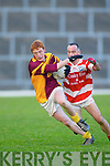 Duaghs Declan Griffin spins past Adrigoles John OShea in their Munster Junior Club Football final in Fitzgerald Stadium.