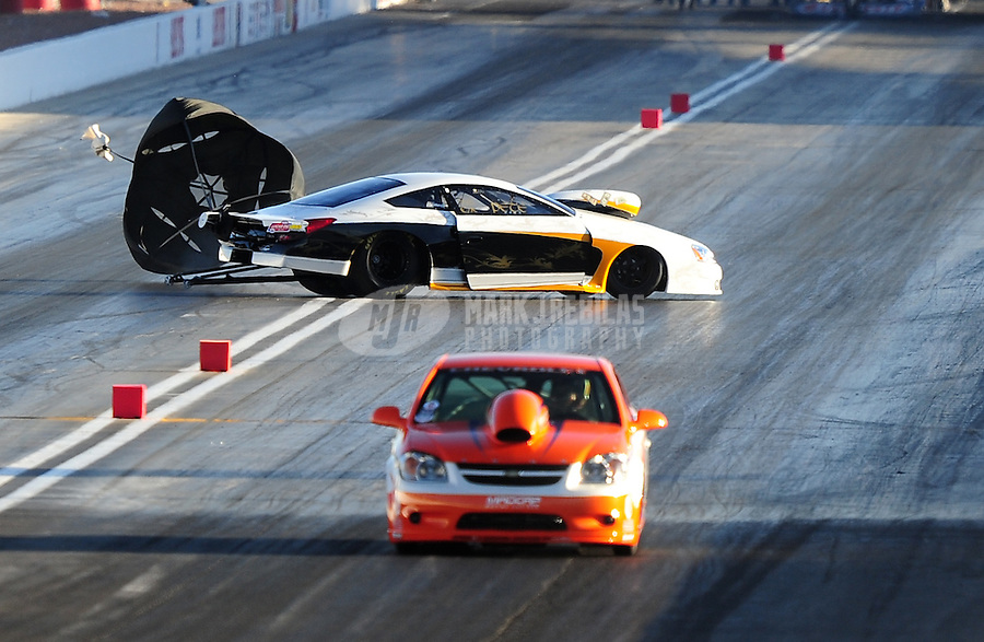 Apr. 4, 2009; Las Vegas, NV, USA: NHRA competition eliminator driver Peter Adams loses control and slides sideways against Justin Lamb during first round of eliminations for the Summitracing.com Nationals at The Strip in Las Vegas. Mandatory Credit: Mark J. Rebilas-