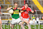 Eamonn Hickson of Kerry shakes off Cork's Anthony J O'Connor last Wednesday night in Pairc Ui Chaoimh, Cork in the Munster GAA Junior Football Championship.