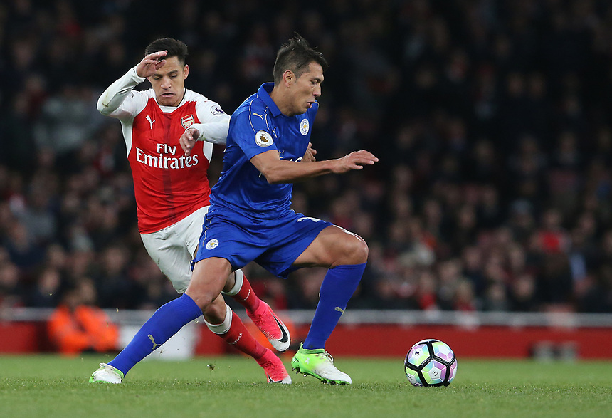 Leicester City's Leonardo Ulloa and Arsenal's Alexis Sanchez<br /> <br /> Photographer Stephen White/CameraSport<br /> <br /> The Premier League - Arsenal v Leicester City - Wednesday 26th April 2017 - Emirates Stadium - London<br /> <br /> World Copyright &copy; 2017 CameraSport. All rights reserved. 43 Linden Ave. Countesthorpe. Leicester. England. LE8 5PG - Tel: +44 (0) 116 277 4147 - admin@camerasport.com - www.camerasport.com