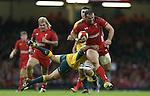 Australia scrum half Nick Phipps dives to stop Wales centre Jamie Roberts.<br /> Dove Men Series 2014<br /> Wales v Australia<br /> Millennium Stadium<br /> 08.11.14<br /> ©Steve Pope-SPORTINGWALES