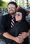 Graduate Whitney Gielow poses for photos with her brother Philip before the 2013 Western Nevada College Commencement at the Pony Express Pavilion, in Carson City, Nev., on Monday, May 20, 2013. .Photo by Cathleen Allison