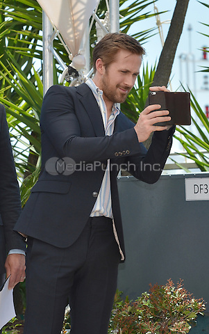 Ryan Gosling takes a picture at the Photocall &acute;The Nice Guys` - 69th Cannes Film Festival on May 15, 2016 in Cannes, France.<br /> CAP/LAF<br /> &copy;Lafitte/Capital Pictures /MediaPunch ***NORTH AND SOUTH AMERICA ONLY***