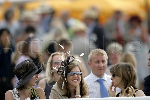 27 July 2004: Young ladies laughing in the Paddock at Goodwood Photo: Glyn Kirk/Action Plus...horse racing 040727 flat fashion glorious