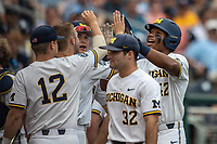 Michigan Wolverines designated hitter Jordan Nwogu (42) celebrates scoring the first run against the Texas Tech Red Raiders during the first game of the NCAA College World Series on June 15, 2019 at TD Ameritrade Park in Omaha, Nebraska. Michigan defeated Texas Tech 5-3. (Andrew Woolley/Four Seam Images)