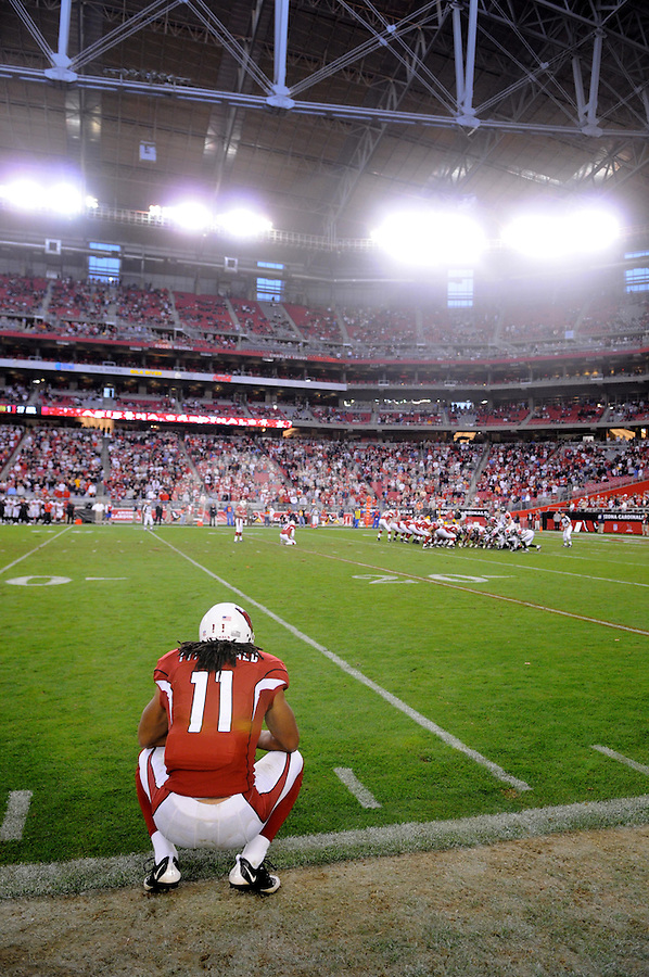 Dec. 23, 2007; Glendale, AZ, USA; Arizona Cardinals wide receiver Larry Fitzgerald (11) looks on as kicker Neil Rackers (1) lines up for the game winning field goal in overtime against the Atlanta Falcons at University of Phoenix Stadium. Mandatory Credit: Mark J. Rebilas-US PRESSWIRE