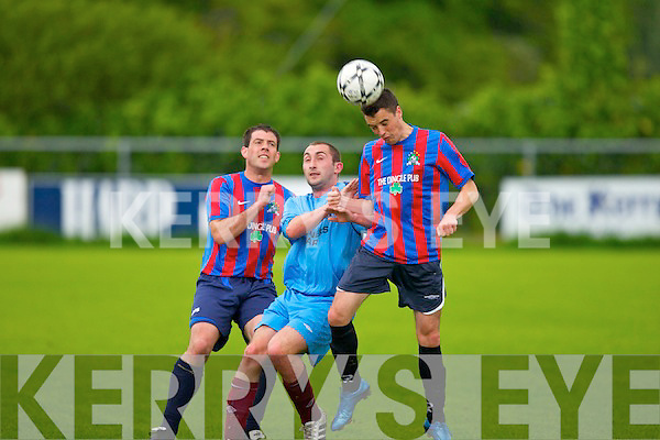 Spa Road's Jamie McIntyre and Dingle Bay Rovers l-r: Dara Flaherty and James Coffey.