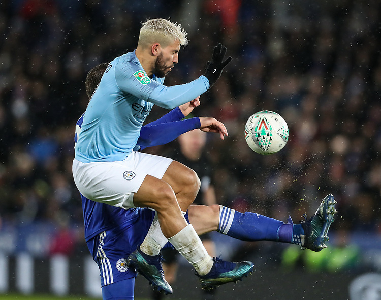 Manchester City's Sergio Aguero competing with Leicester City's Christian Fuchs<br /> <br /> Photographer Andrew Kearns/CameraSport<br /> <br /> English League Cup - Carabao Cup Quarter Final - Leicester City v Manchester City - Tuesday 18th December 2018 - King Power Stadium - Leicester<br />  <br /> World Copyright © 2018 CameraSport. All rights reserved. 43 Linden Ave. Countesthorpe. Leicester. England. LE8 5PG - Tel: +44 (0) 116 277 4147 - admin@camerasport.com - www.camerasport.com