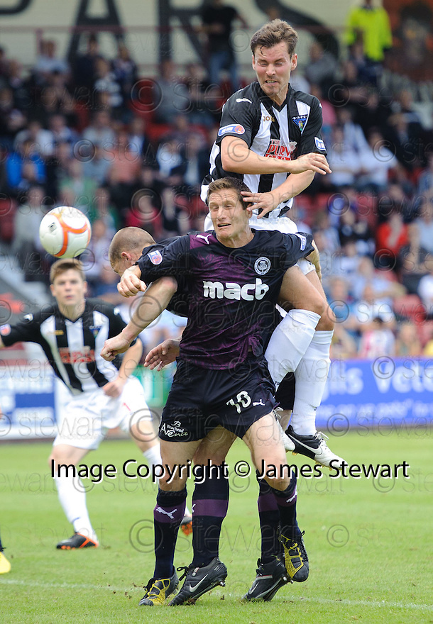 Dunfermline's Andy Barrowman's gets above Hugh Murray but his header goes wide.