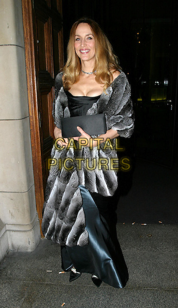 JERRY HALL.Cirque Du Soleil charity performance at the Royal Albert Hall and aftershow dinner at the V&A Museum.5 February 2004.full length, full-length, fur coat.www.capitalpictures.com.sales@capitalpictures.com.© Capital Pictures.