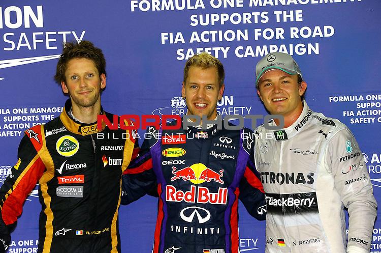19.-22.09.2013, Marina-Bay-Street-Circuit, Singapur, SIN, F1, Grosser Preis von Singapur, Singapur, Romain Grosjean (FRA) Lotus Renault F1 Team - Sebastian Vettel (GER), Red Bull Racing - Nico Rosberg (GER), Mercedes GP <br /> for Austria &amp; Germany Media usage only!<br />  Foto &copy; nph / Mathis