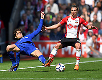 Chelsea's Marcos Alonso (left) is tackled by Southampton's Cedric Soares (right) <br /> <br /> Photographer David Horton/CameraSport<br /> <br /> The Premier League - Southampton v Chelsea - Saturday 14th April2018 - St Mary's Stadium - Southampton<br /> <br /> World Copyright &copy; 2018 CameraSport. All rights reserved. 43 Linden Ave. Countesthorpe. Leicester. England. LE8 5PG - Tel: +44 (0) 116 277 4147 - admin@camerasport.com - www.camerasport.com