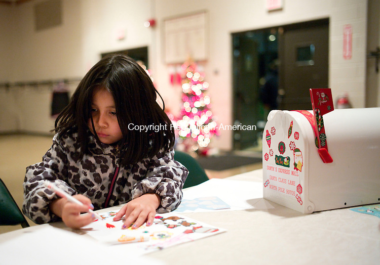 Torrington, CT- 04 December 2015-1204115CM14-  Zalisha Borja 5 of  Torrington works on a letter to Santa during a Christmas Village Toy Shower at Coe Park in Torrington on Friday.   The event which featured musical performances, crafts and refreshments was held to raise money to support the town's Christmas Village and to<br /> purchase toys for all children who visit Santa at the Village.       Christopher Massa Republican-American