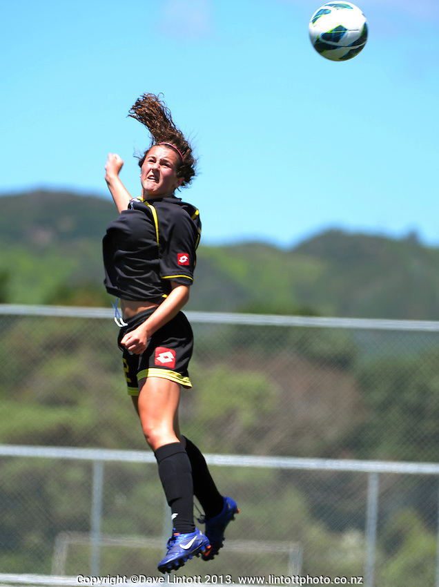 during the ASB Women's League football semifinal match between Capital (black with yellow trim) and Mainland (red and black) at Petone Memorial Park, Wellington, New Zealand on Sunday, 1 December 2013. Photo: Dave Lintott / lintottphoto.co.nz