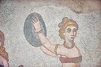Roman mosaics a girl dancing with a drum from the Room of the Ten Bikini Girls, room no 30, from the Ambulatory of The Great Hunt, room no 28,  at the Villa Romana del Casale which containis the richest, largest and most complex collection of Roman mosaics in the world. Constructed in the first quarter of the 4th century AD. Sicily, Italy. A UNESCO World Heritage Site.
