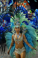 A dancer from Grande Rio samba school performs at the Sambadrome during the samba school parade in Rio de Janeiro, Brazil, February 22, 2009. The Grande Rio Samba school parade pays tribute to France during Rio de Janeiro's 2009 carnival celebrations.