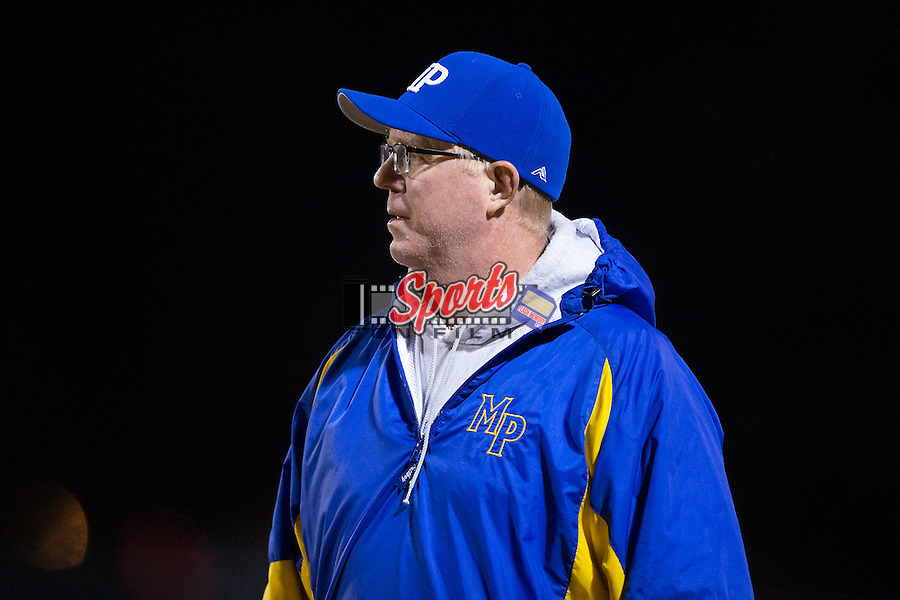 A Mount Pleasant Tigers coach watches the action from the sidelines during first half action against the Shelby Golden Lions at George Blanton Memorial Stadium November 27, 2015, in Shelby, North Carolina.  The Golden Lions defeated the Tigers 38-27.  (Brian Westerholt/Sports On Film)