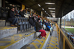Prescot Cables 2 Brighouse Town 1, 13/02/2016. Hope Street, Northern Premier League. Spectators in the main stand watching the second-half action as Prescot Cables (in orange) take on Brighouse Town in a Northern Premier League division one north fixture at Valerie Park. Founded in 1884, the 'Cables' in their name came from the largest local employer, British Insulated Cables and they have played in their current ground, also known as Hope Street, since 1906. Prescott won the match 2-1 watched by a crowd of 189. Photo by Colin McPherson.