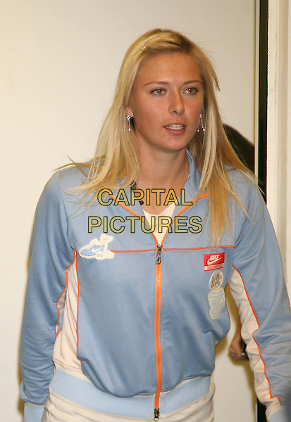 MARIA SHARAPOVA.At a photocall to launch Gatorade drink in the UK at a press conference held at a school in Wimbledon, London, England, UK, 18th June 2008.half length blue top zip-up nike sporty .CAP/DS.©Dudley Smith/Capital Pictures