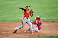 Aberdeen IronBirds second baseman Alejandro Juvier (6) throws to first base as Mike Garzillo (11) slides in during a game against the Batavia Muckdogs on July 15, 2016 at Dwyer Stadium in Batavia, New York.  Aberdeen defeated Batavia 4-2.  (Mike Janes/Four Seam Images)