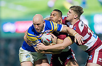 Picture by Allan McKenzie/SWpix.com - 13/04/2018 - Rugby League - Betfred Super League - Leeds Rhinos v Wigan Warriors - Headingley Carnegie Stadium, Leeds, England - Leeds's Carl Ablett is tackled by Wigan's Willie Isa & Ryan Sutton.