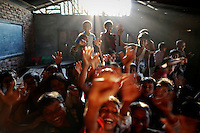 Rohingya Muslim children react as they are photographed inside a school at the camp for people displaced by violence near Sittwe April 26, 2013. Picture taken April 26, 2013.   REUTERS/Damir Sagolj (MYANMAR)