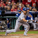 13 October 2016: Los Angeles Dodgers infielder Charlie Culberson attempts a pinch hit sacrifice bunt in the 7th inning of the NLDS Game 5 against the Washington Nationals at Nationals Park in Washington, DC. The Dodgers edged out the Nationals 4-3, to take Game 5, and the Series, 3 games to 2, moving on to the National League Championship against the Chicago Cubs. Mandatory Credit: Ed Wolfstein Photo *** RAW (NEF) Image File Available ***