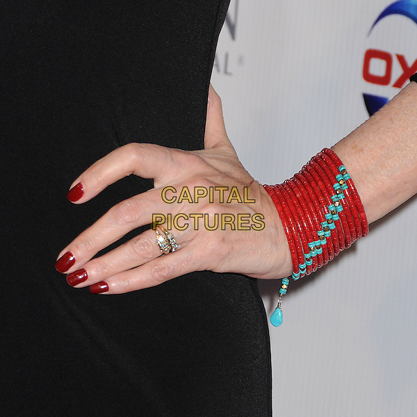Susan Blakely.8th Annual American Red Cross Red Tie Affair held at the Fairmont Miramar Hotel, Santa Monica, California,   USA, 6th April 2013..detail hand ring bracelet gold rings cuff beaded red turquoise .CAP/ADM/BP.©Byron Purvis/AdMedia/Capital Pictures.